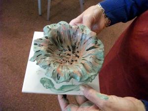 holding pot like flower
